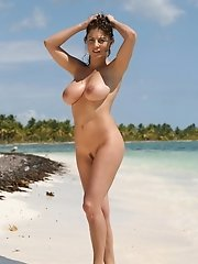 Hot busty babe Roberta Missoni gets naked and show us her really huge tits and shaved pussy on some Caribbean beach